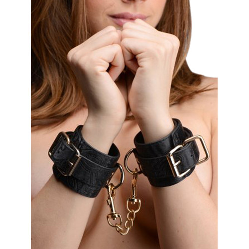 Schwarze Handfesseln mit Stickereien